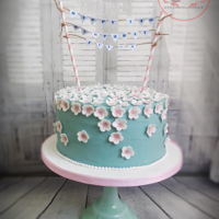 Floral Turquoise Sometimes simplicity is the best! Devil's Food Cake decorated with buttercream and sugar flowers :) Enjoy!
