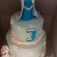 "Frozen Birthday Cake An 8""Vanilla cake with lemon curd filling and 6"" chocolate cake with strawberry jam. Covered with cooked buttercream and Elsa,..."
