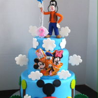 Goofy Birthday Cake Two-tiered cake with handmade fondant goofy topper