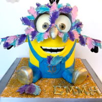 Masquerade Minion Feathers are hand cut, dusted, and painted.. made of gumpaste. All fondant. Fun cake to design!!:). Thanks for looking!www.facebook.com/...
