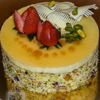 Palomo Torte European style torte. Dried fruits and nuts joconde. Inside layers of pistachio dacquoise, strawberry moistened genoise, mascarpone cream...