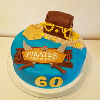 "Pirates Tides Of Fortune Birthday cake for a big fan of the fb game ""PIRATES - Tides of Fortune""Cake is filled with strawberrycream"