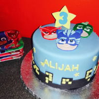 Pj Masks Cute lil PJ Masks cake for a 3rd Birthday Party! Chocolate cake w/ vanilla butter cream & fondant.
