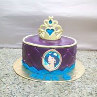 Princess Jasmine red velvet cake filled with cream cheese frosting, covered in fondant. crown is gum paste