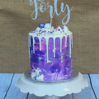 Purple Silver Drip Cake Vanilla cake with Italian meringue buttercream and white chocolate ganache drip