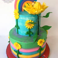 Rainbows And Sunflowers A gender reveal cake with matching cupcakes:). Rainbow and large sunflower are gumpaste, the rest is fondant. All buttercream cake!! Thanks...