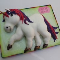Rainbows And Unicorns This was a chocolate biscuit cake carved from a large square for a little girl who loves Unicorns.
