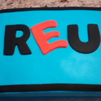 Reu Cake Redding Electric Utility Chocolate cake with chocolate buttercream covered with fondant.
