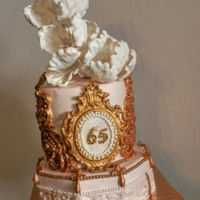 Rosé Cake Fondant cake.with White flowers