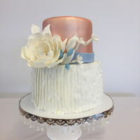 Rose Gold And Ruffles I made this for a friends wedding. Both tiers were vanilla cake with a cheesecake mousse and raspberry fillings. Accented with gumpaste...