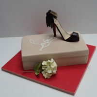 Shoe Addict This was a Madeira cake covered in Fondant and shoe made from Gumpaste.