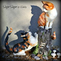 Siblings - Animal Rights Collaboration 2016 This piece is made of modeling chocolate over Rice Krispy Treats with a wire armature. The tree stump is made of Satin Ice Chocolate...