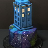 Tardis On Mirror Glaze RKT tardis sitting atop a perfect galaxy mirror glaze cake!