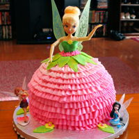 Tinkerbell Doll Cake With Ruffles This is for my 5 year old Granddaughter, who is sharing her Birthday with her little brother. Fairies and Pirates themed.