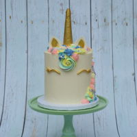 Unicorn Cake Vanilla Cake with Italian meringue buttercream and fondant embellishments