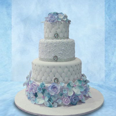 Blue Floral White tiers adorned with hand-piped detail and blue floral accents.