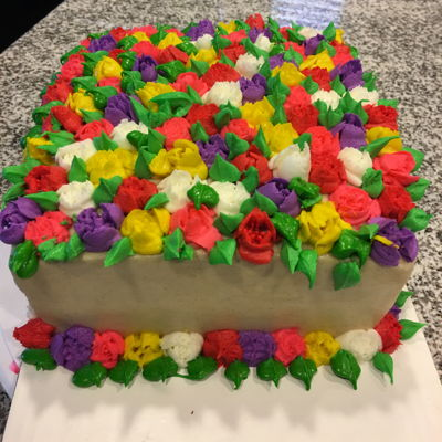 Bouquet Of Flowers Cake. Snickerdoodle cake with buttercream roses and tulips.