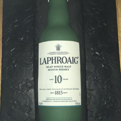 Laphroaig Whisky Bottle Fruit Birthday Cake This was made for a birthday. I made a bar fruit cake flavoured with Laphroaig whisky. I moulded a whisky bottle out of fondant mixed with...