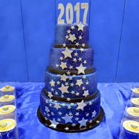 2017 Graduation Cake 4 tier airbrushed and fondant covered cake with fondant accents and gumpaste topper.