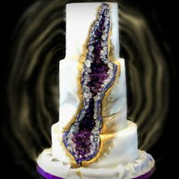 50Th Anniversary Geode Cake Three tiers - chocolate with chocolate buttercream filling, frosted with vanilla buttercream, French vanilla and strawberry both with cream...