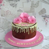 60Th Birthday - Drip Cake Cake to celebrate 60th birthday. Chocolate drip cake decorated with pink wafer paper roses.
