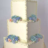 A Wish Your Heart Makes 100% Buttercream - Cinderella Inspired Buttercream Wedding Cake, with hand piped Buttercream flowers and Scrollwork, by Kerrie Wyer.