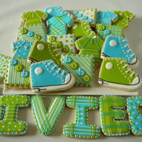 Baby Boy Cookie Set Baby boy cookie set for Olivier. Converse shoes and body suit. Butter cookies with royal icing.