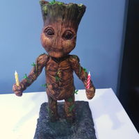 Baby Groot 3D Cake This cake is 17 inches tall his head and body are all cake. I used modeling chocolate for his arms and legs and then painted him. Lemon...