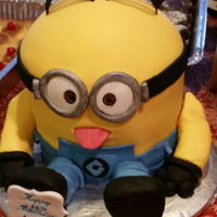 Birthday Cake Minion cake & krispie treat legs and arms.