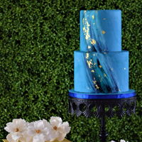 Blue Beauty Blue marbled fondant covers this 12 inch high two tier cake. Accented with hand painted streaks and gold leaf. As well as 4 sugar flower (...