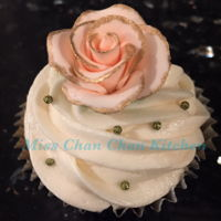 Bridal Shower Party Pink rose gold cupcakes, wedding dresses and cake cookies.