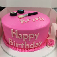 Bright Pink Birthday Cake 9-inch chocolate cake with bright pink buttercream frosting. Fondant MAC make up and brush, and gumpaste stiletto.