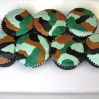 Camo Cupcakes American Buttercream piped camo cupcakes. smoothed with parchment paper on top.