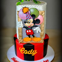 "Cody's Mickey Mouse Birthday Cake It was my privilege to do my first Icing Smiles cake for 3 year old Cody. Bottom tier is 10"" x 6"" rich chocolate with chocolate..."