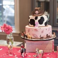 Cowgirl Party Cowgirl cake in buttercream with fondant accents