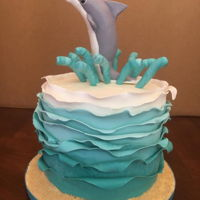 Dolphin Cake Dolphin and wave made from modeling chocolate. Black forest cake with cream cheese buttercream.