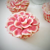 Flower Cupcakes Cupcake decorated with buttercream two tone petals. Here's the tutorial on how to make this: