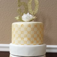 Hello Fifty Two tier stenciled gold painted fondant and gumpaste white peony