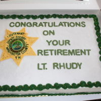 Lieutenant's Retirement This cake was made for another co-worker retiring after 30 years. Buttercream with fondant accents.