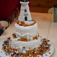 Lighthouse Anniversary Base layers are cake and the lighthouse is made from rice krispie treats. All are covered in fondant. The sand is just graham crackers and...