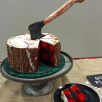 Lumberjack Cake For Retirement Party Lumberjack cake with plaid cake inside and bark texture outside.