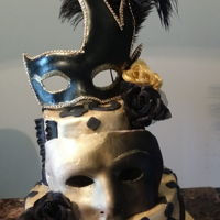 Masquerade Cake Yellow batter cake covered with buttercream and fondant. Gumpaste mask. Black and gold.