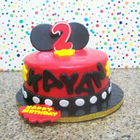 Mickey Mouse Cake chocolate cake covered in fondant, ears made of gum paste
