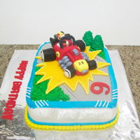 Mickey Mouse Racing Car chocolate cake covered in fondant, car made of gum paste