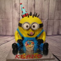 Minion Cake My first minions cake. Loved making it as a gift en he whas very happy with it. :-)