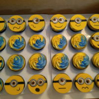Minion Themed Cupcakes Fondant toppers with buttercream.
