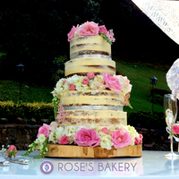 Naked Cake With Hydrangeas And Roses Vanilla and poppy seed cake with irish cream filling