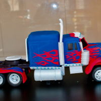Optimus Prime Cake Transformer Optimus Prime made with chocolate cake. Working LED lights were put on it for special effectCan be checked on ( ) for full...