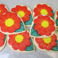 Orange Flower Cookies NFSC sugar cookies, piped with corn syrup glaze.