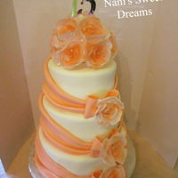 Peach 15 Peach swags and bows with airbrushed wafer paper roses, made for a quinceanera.